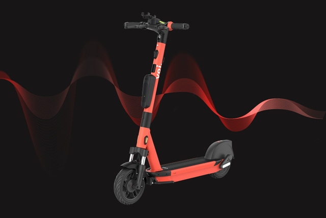 A Red Scooter in from of a Red Soundwave