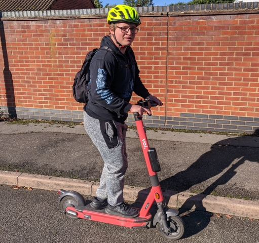 user on voi e-scooter