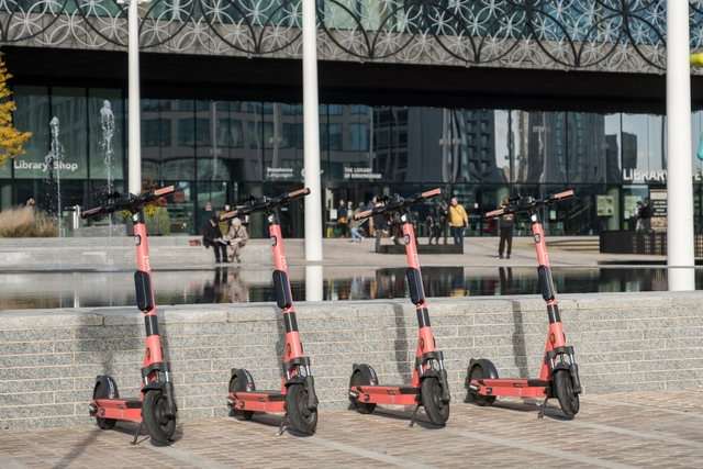 four Voi scooters parked in the UK