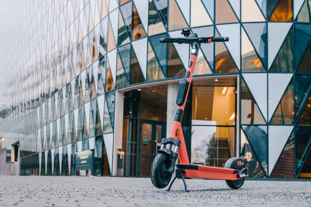 photo of the new V4 e-scooter in front of a building