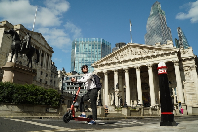 man on voi e-scooter in London
