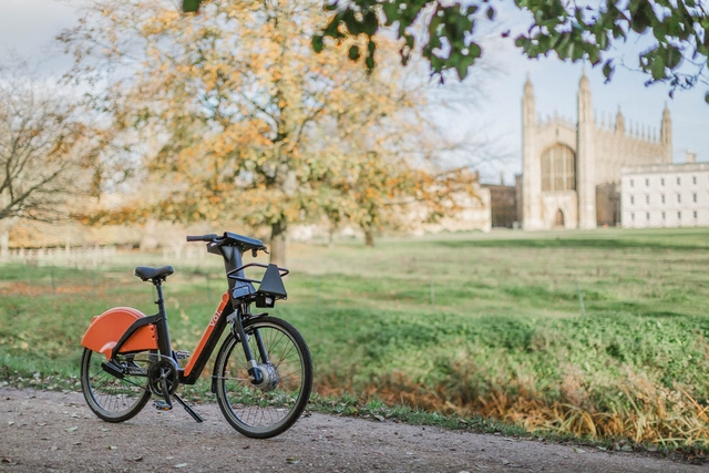 An electric bike left in the park.