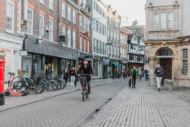 A man on an e-bike cycling on the street