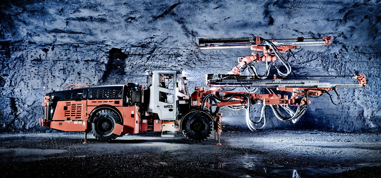 Updates with Sandvik DD422i and Sandvik DD422iE development rigs include a new boom collision avoidance system and semi-automatic drill bit changer.