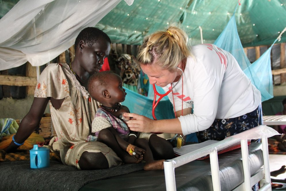MSF Medical Doctor Pippa Pett examines a child in the MSF IPD ward in Thonyor, South Sudan.